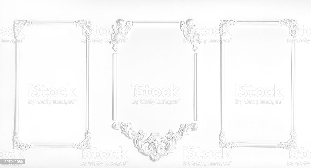 White wall decorated with stucco and molding stock photo