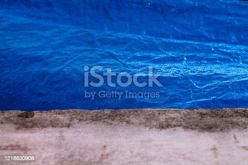 white wall with a piece of blue plastic for backgroundin in rio de janeiro.