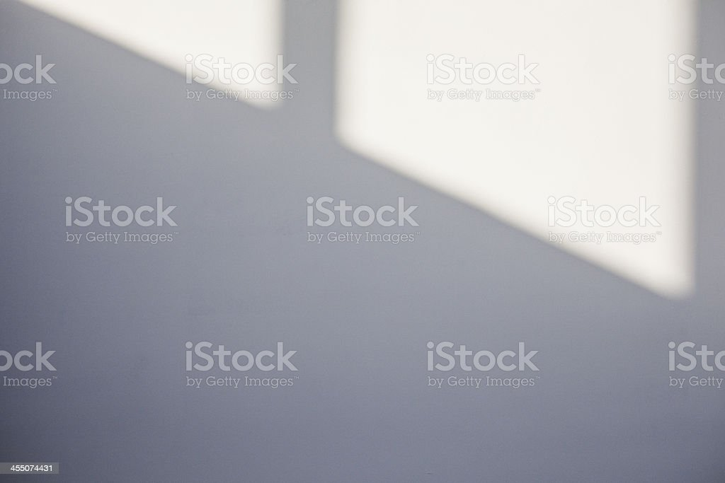 White wall with a window shadow. stock photo