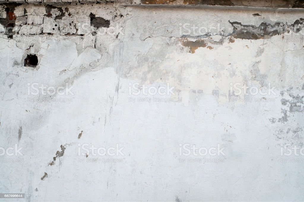 White wall with cracks royalty-free stock photo