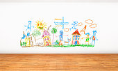 White wall with crayon drawings and doodles painted by kids