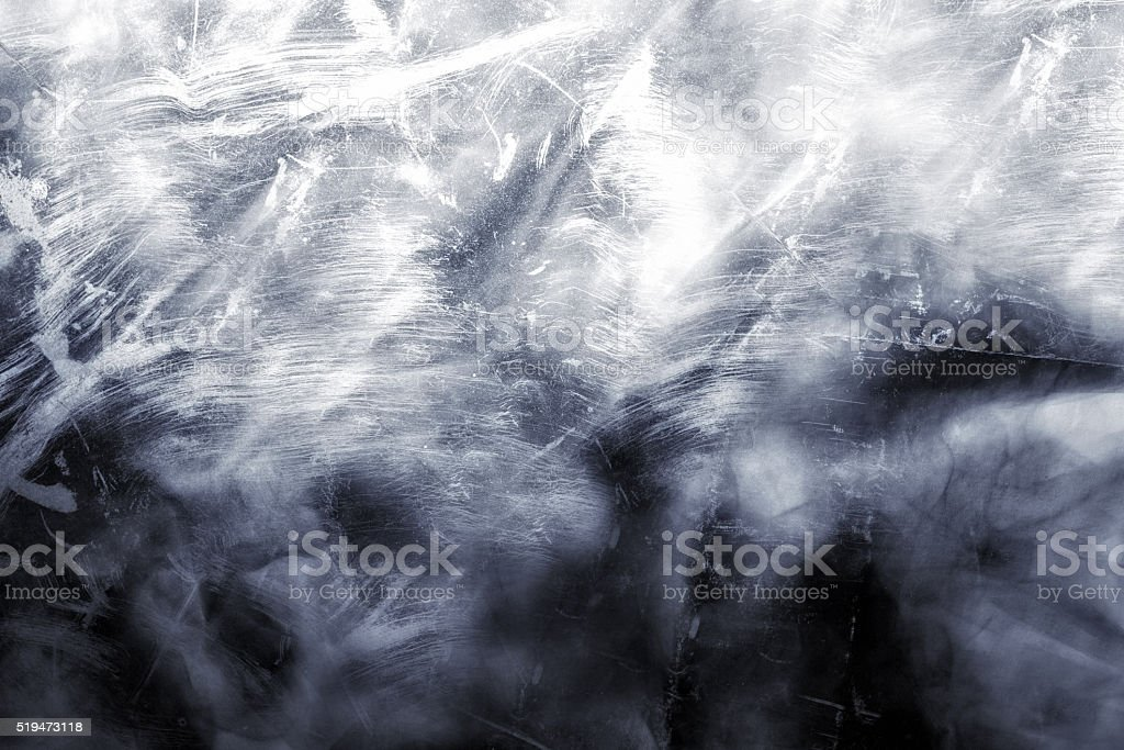 White wall with patches of soot stock photo