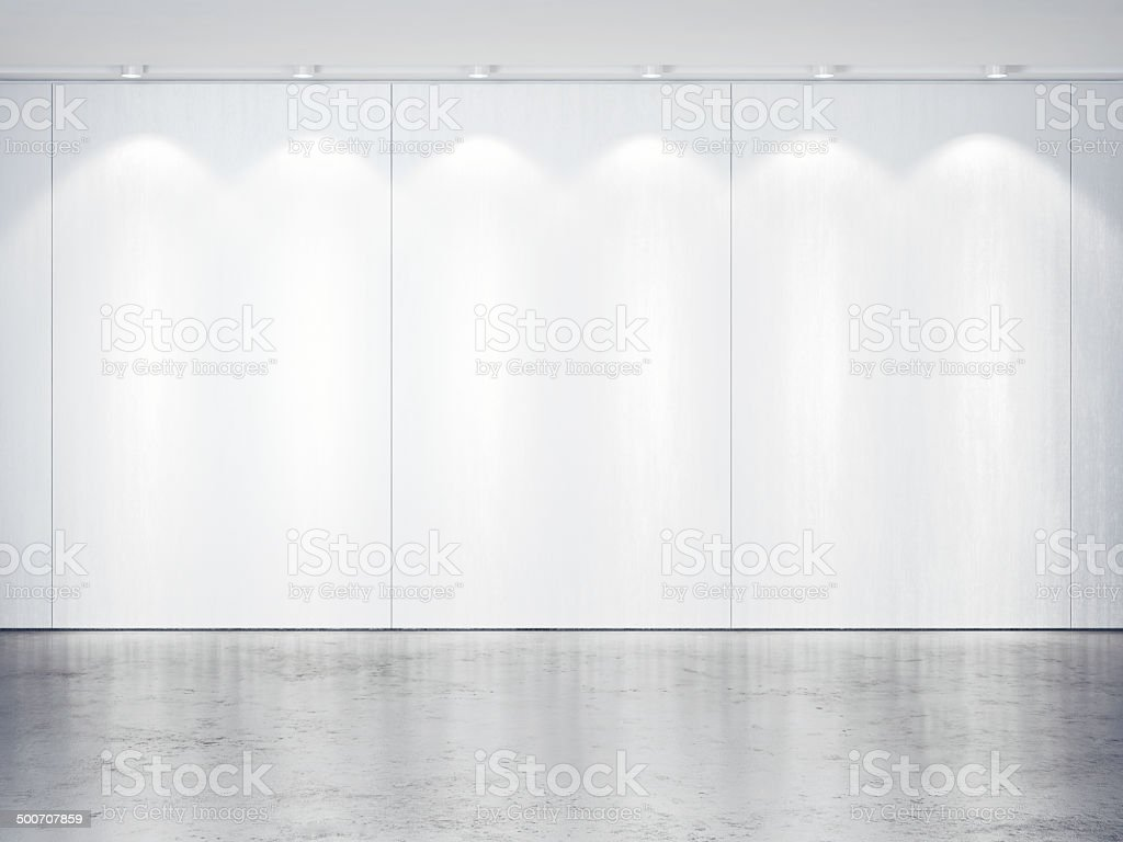 White wall with spotlights. Concrete floor. stock photo