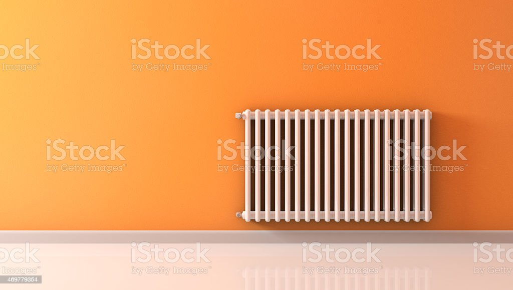White wall-mounted radiator on an orange wall stock photo