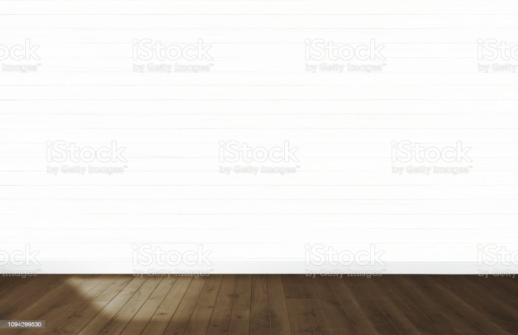 White Wallpaper In An Empty Room With Wooden Floor Stock Photo