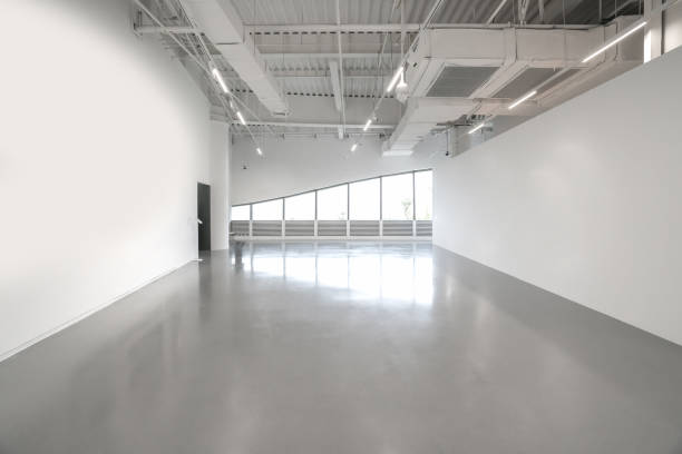 White walls and grey cement floors in the interior space stock photo