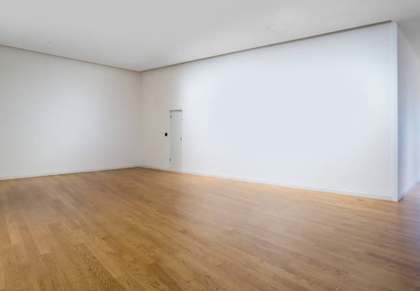 White walls and wooden floors in empty rooms stock photo