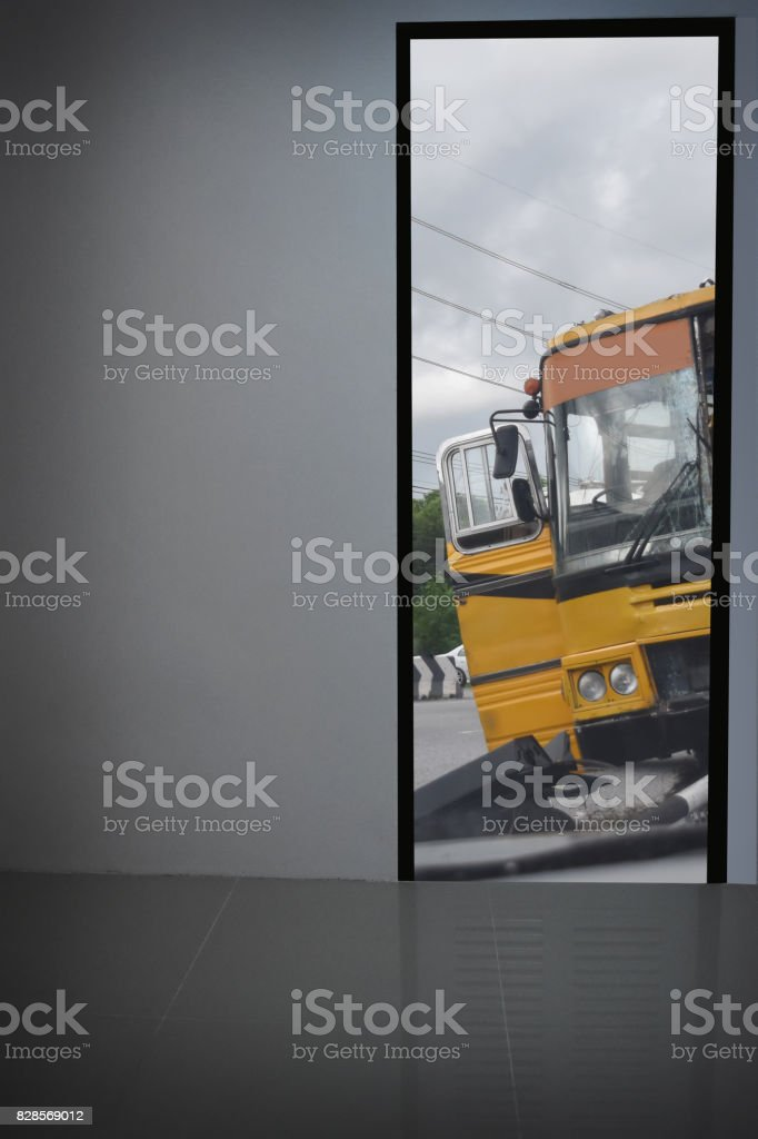 White walls look out the door. See yellow bus accident and left bank and empty space for text or foreground with clipping path.- school bus stock photo