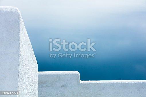 istock White walls of a Greek house under stormy sky, Isle of Naxos, Cyclades, Greece 909747774