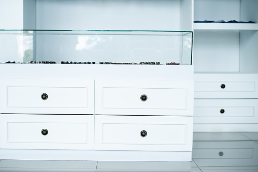 white wardrobe chest of drawers, interior dressing room, store