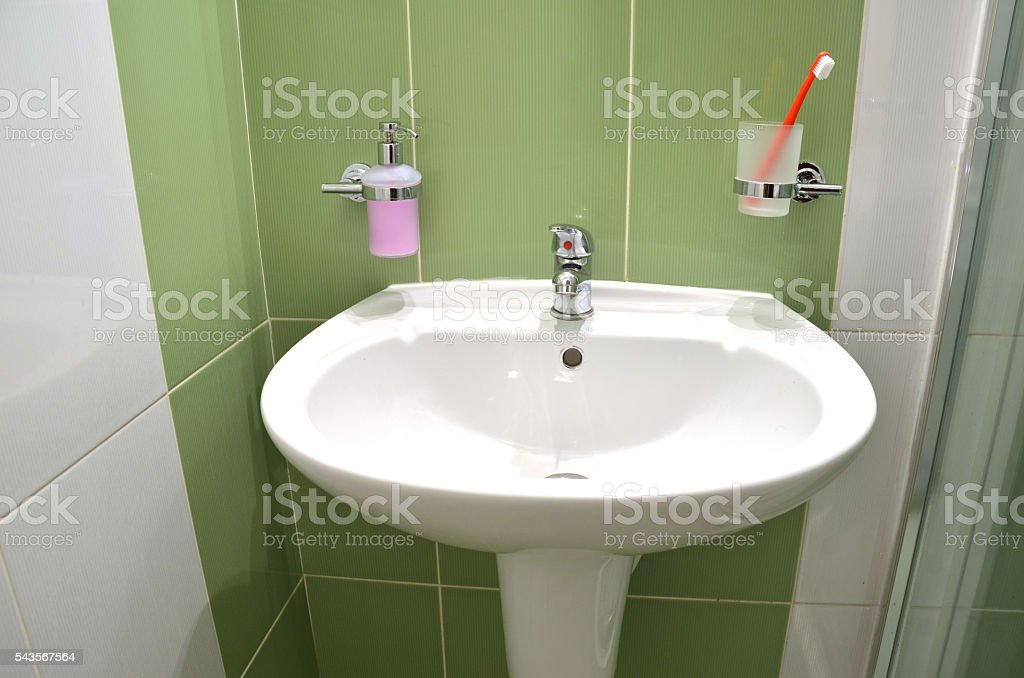 White Wash Basin In White Green Tiled Bathroom Stock Photo More