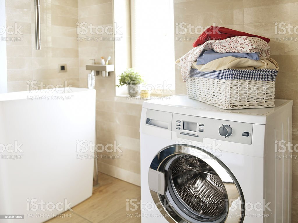 White washing machine in the bathroom stock photo
