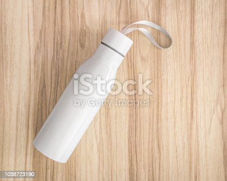 1129148925istockphoto White water bottle on wood background. Insulated container for keep your drink. 1038723190