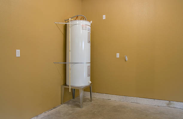 White water heater in corner of unfinished room stock photo