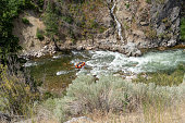 White water rafters go down a Class 3 rapids along the Payette River during summertime in Garden Valley Idaho