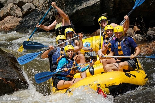 Fort Collins, Colorado, USA - July 20, 2014: A group of people enjoying white water rafting the Poudre River outside of Fort Collins, Colorado.