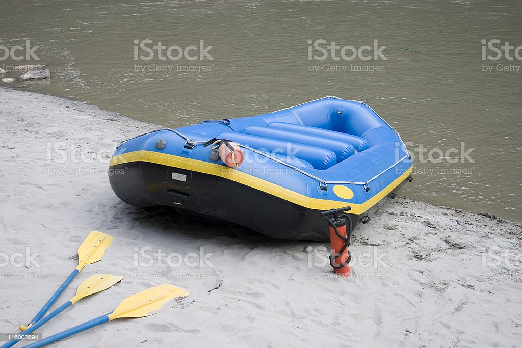 White Water Rafting Empty Raft Bank of River Ganga Rishikesh stock photo