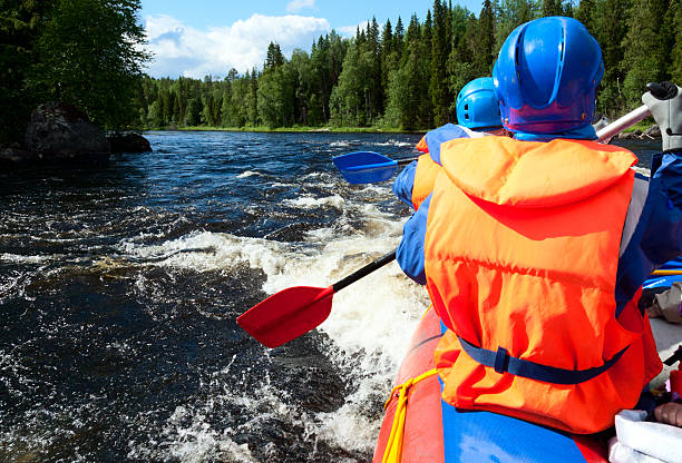 White water rafting Rafters in a rafting boat on Pistojoki river in Karelia, Russia republic of karelia russia stock pictures, royalty-free photos & images