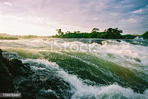 The rapids of the River Nile at the source out of Lake Victoria at Jinja Town, Uganda at sunrise.
