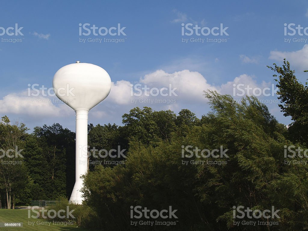 White Water Tower Against a Blue Sky royalty-free stock photo