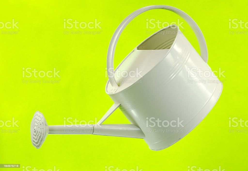 White Watering Can on Marbled Green stock photo