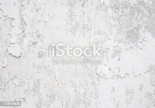 White weathered wall with flaking paint background/texture.