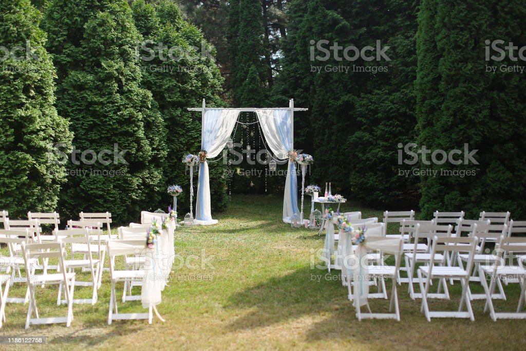 White Wedding Arch In Park And Decorated Chairs Stock Photo Download Image Now Istock