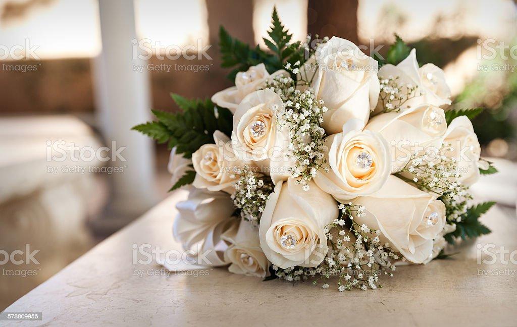 White wedding bouquet in sepia tones stock photo