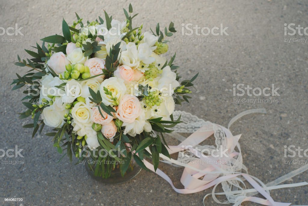 White Wedding Bouquet Roses Pink flowers and Ruscus Leaves with Robbons on Gray Asphalt Background. Wedding Decoration - Royalty-free Adult Stock Photo