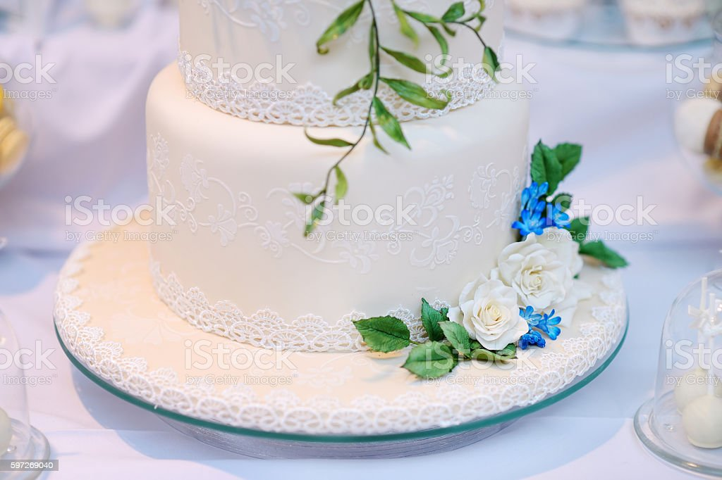 White wedding cake decorated with flowers royalty-free stock photo