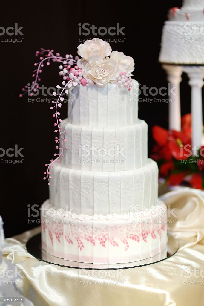 White wedding cake decorated with pink flowers stock photo more white wedding cake decorated with pink flowers royalty free stock photo mightylinksfo