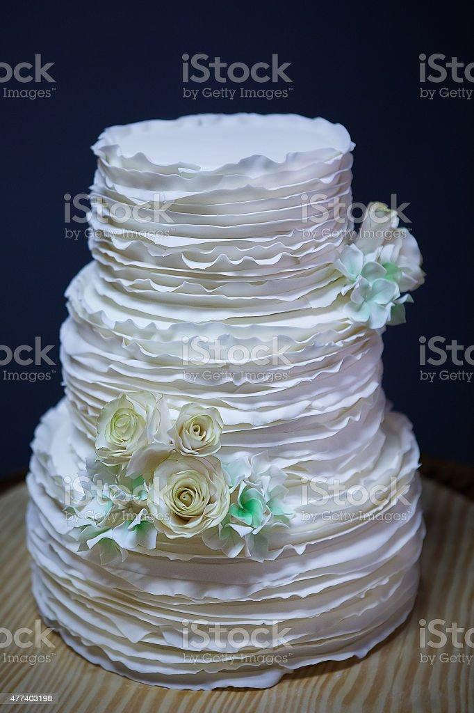 white wedding cake on table stock photo