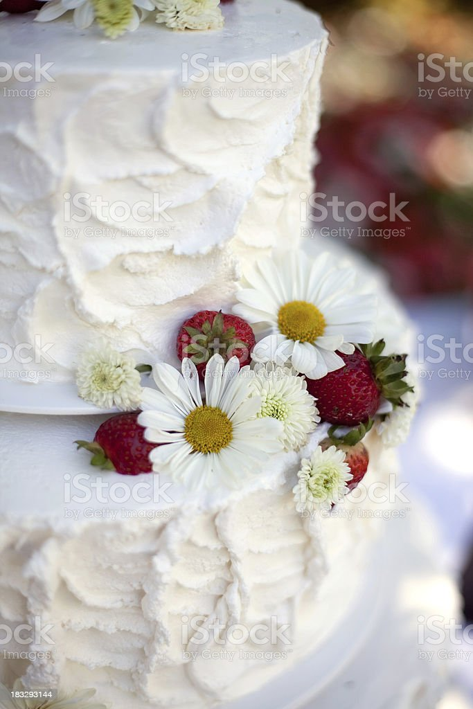 White wedding cake with berries and flowers royalty-free stock photo