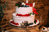 White wedding cake with berries on a tray