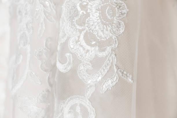white wedding dress embroidered lace detail - koronka zdjęcia i obrazy z banku zdjęć