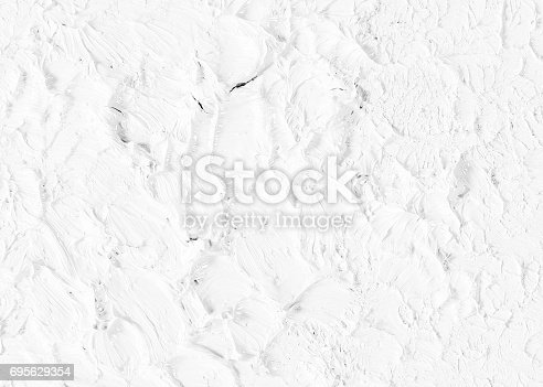 1138442636istockphoto White wet paint texture on decorative surface wall. 695629354