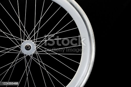 Close-up to a white wheel of a bicycle