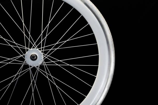 vitt hjul på en cykel - wheel black background bildbanksfoton och bilder