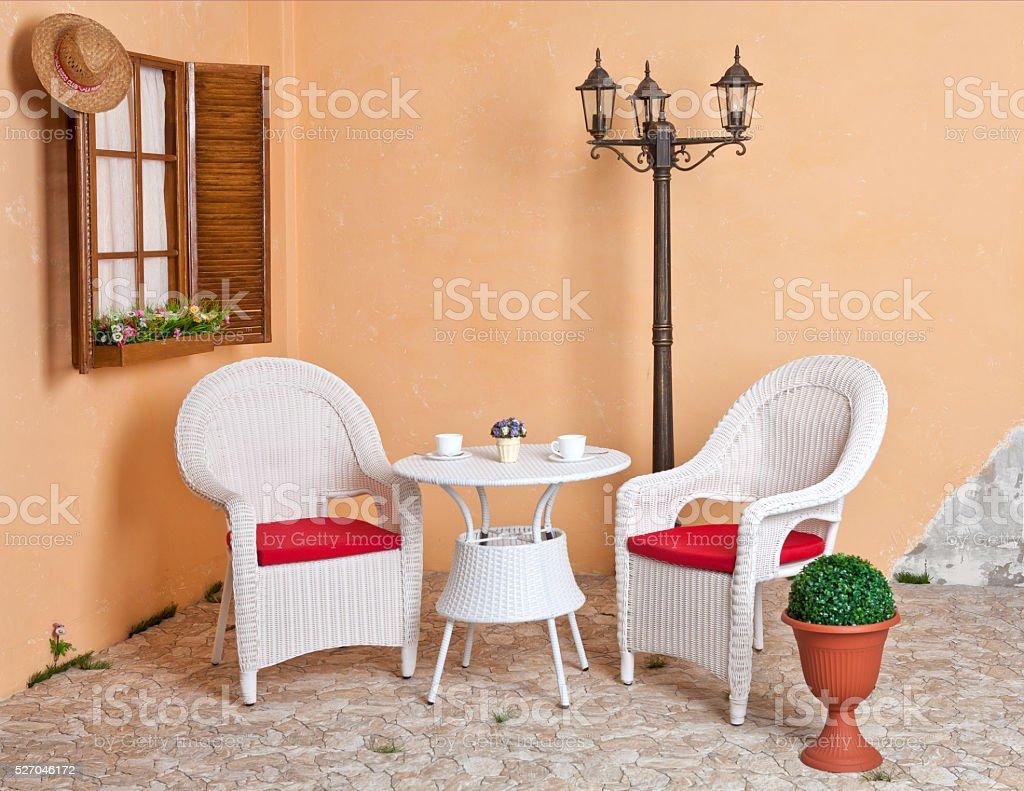 White wicker furniture Rattan European internal courtyard. stock photo
