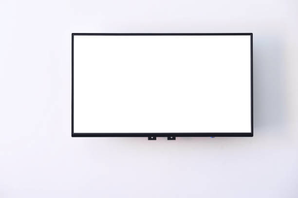 white wide screen tv digital hanging on white wall background - monitor foto e immagini stock