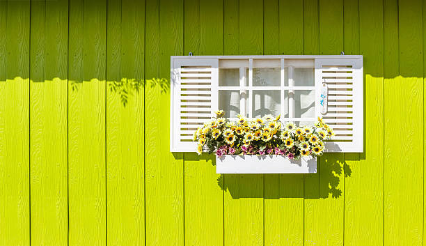 White window and wooden walls yellow. It's colorful. stock photo