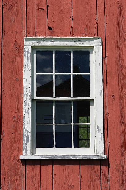 White Window in Red Barn Wall stock photo