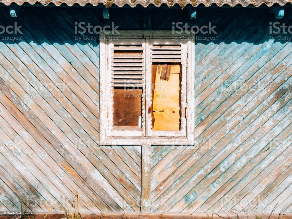 White window shutters. The facade of houses royalty-free stock photo