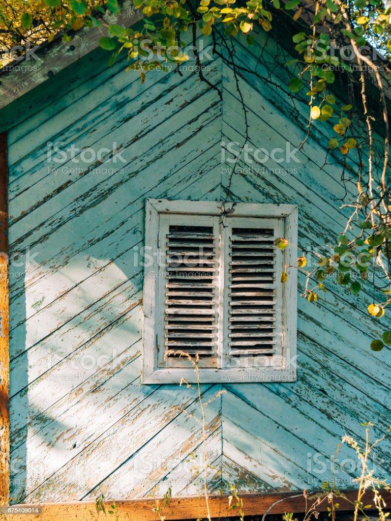 White window shutters. The facade of houses photo libre de droits