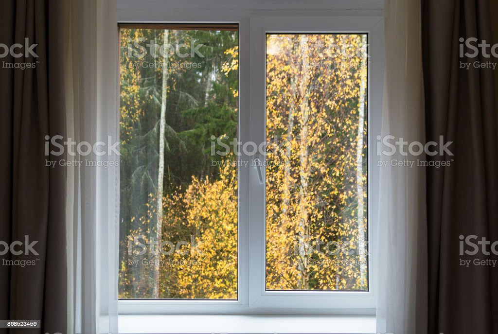 White window with sill and autumn landscape, interior with window in autumn day stock photo
