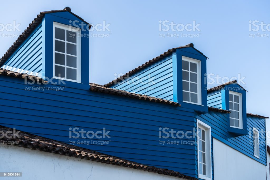 White windows of a nice blue house in a small village, Pico, Azores, Portugal stock photo