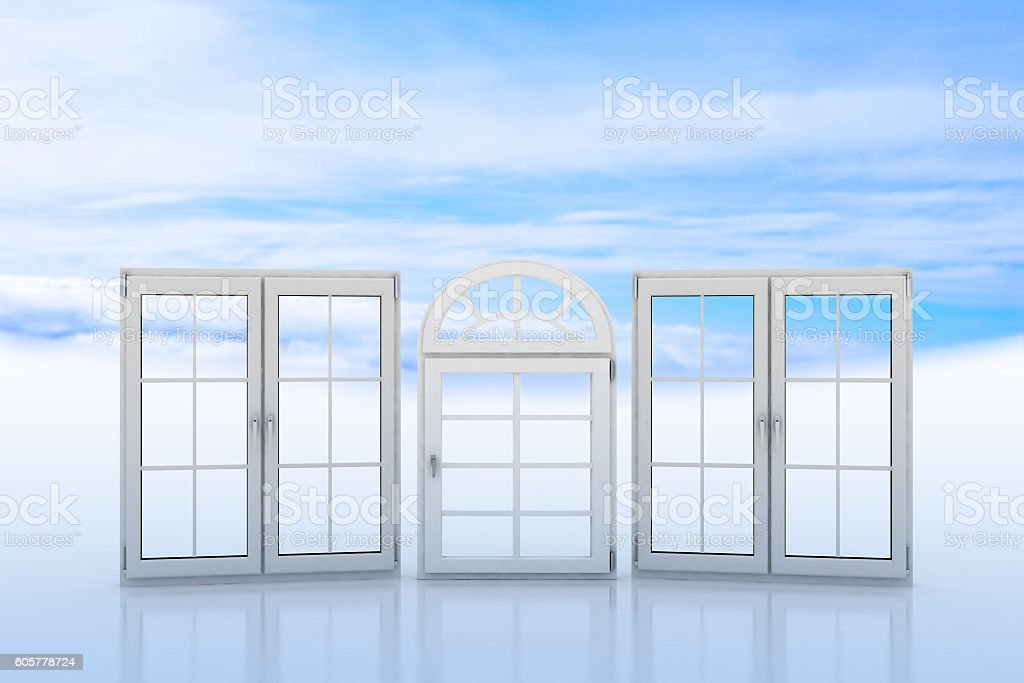 White windows with blue sky and clouds on background stock photo