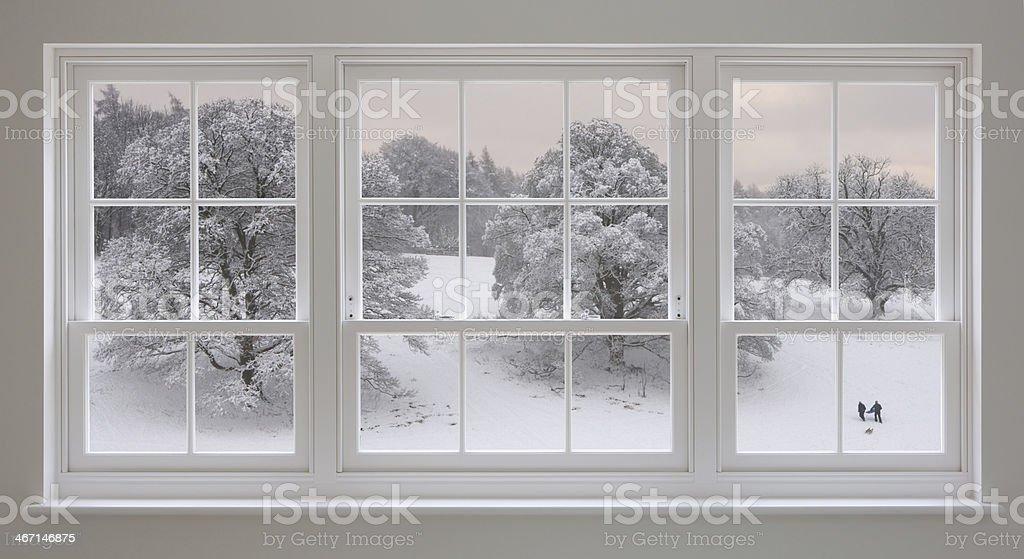 White windows with wintery views stock photo