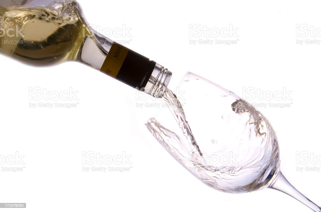 White wine being poured into a glass royalty-free stock photo