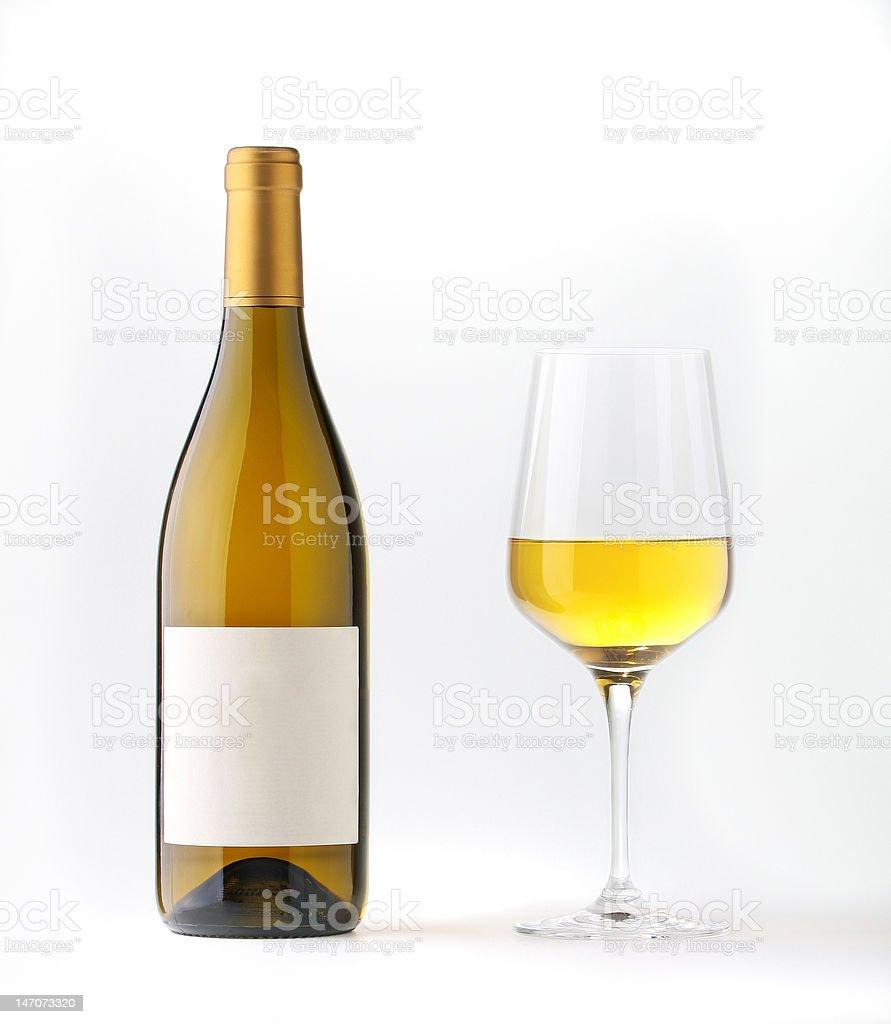 Bouteille de vin blanc avec étiquette vierge et d'un verre - Photo